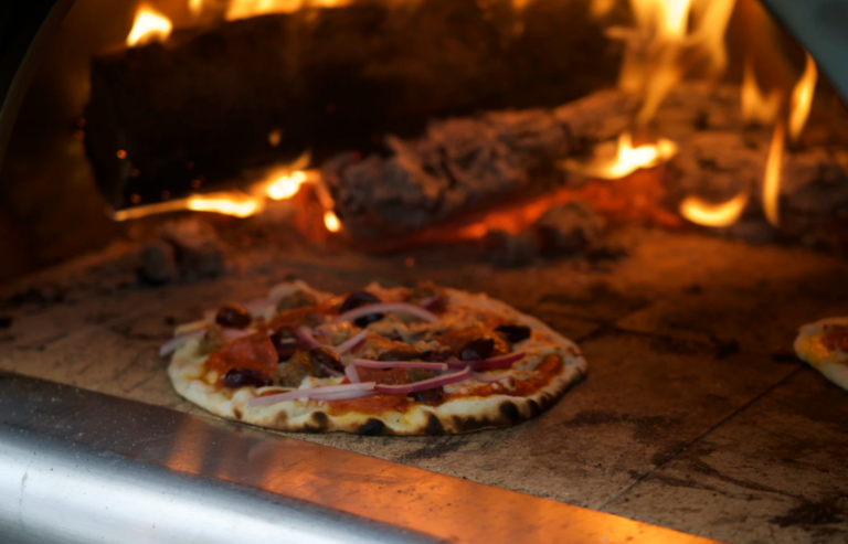 cooked pizza in hot pizza oven